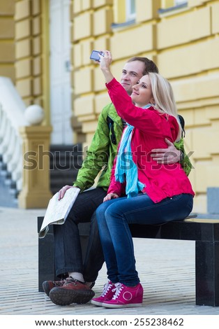 Happy couple on travel vacation holidays. Romantic young beautiful couple taking self-portrait