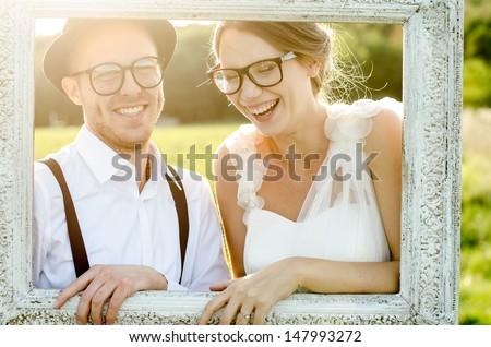 Happy couple on wedding day. Bride and Groom. Vintage wedding. - stock photo