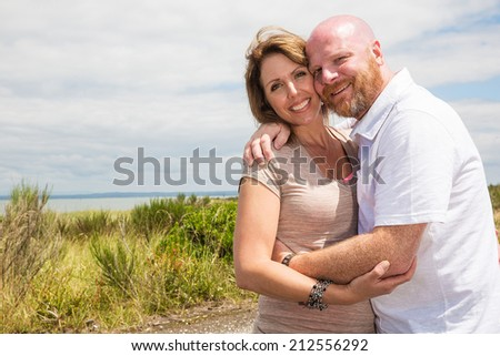 happy couple outside  - stock photo