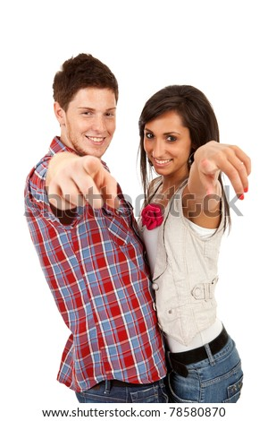 Happy couple pointing at the camera - isolated over white