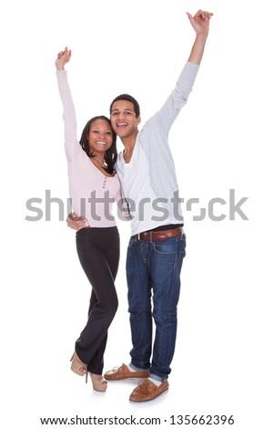 Happy Couple Raising Hand Over White Background - stock photo