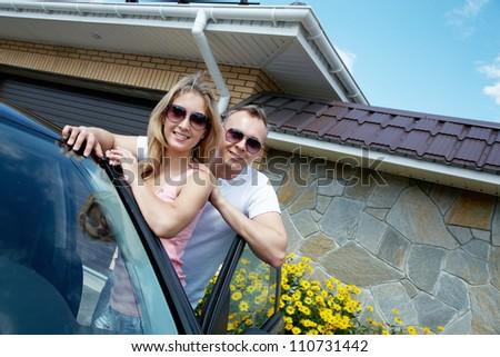 Happy couple ready for honeymoon journey - stock photo