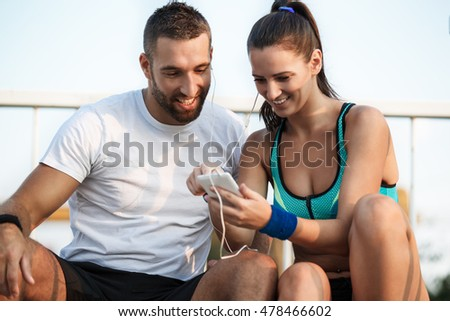 Happy couple relaxing after exercising outdoors. Living healthy lifestyle.