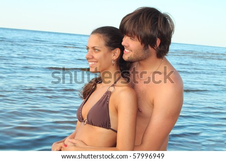 Happy couple relaxing at the seaside