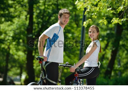 Happy couple ride bicycle outdoors, health lifestyle fun love romance concept