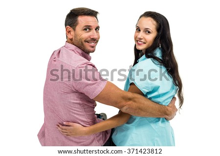 Happy couple sitting and looking at camera on white screen - stock photo