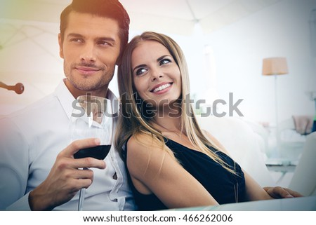 Happy couple sitting in restaurant