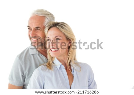 Happy couple smiling and embracing on white background