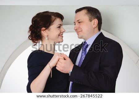 happy couple smiling and hugging, Studio portrait - stock photo
