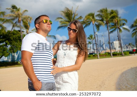 Happy couple spending romantic time together on beach. Loving couple hugging each other. Summer luxury vacation in Hawaii. - stock photo
