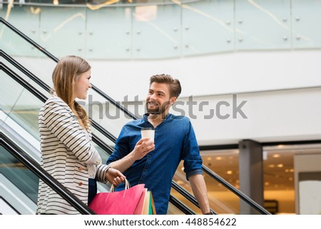 Happy couple spending time shopping - stock photo