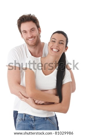 Happy couple standing over white background, laughing.? - stock photo