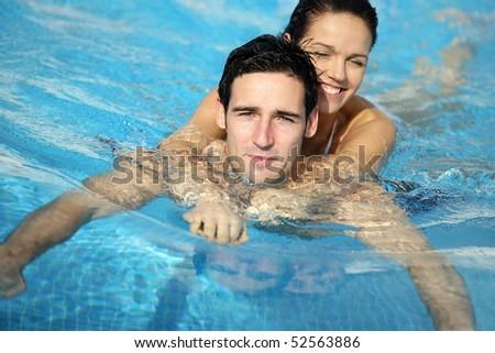 Happy couple swimming - stock photo