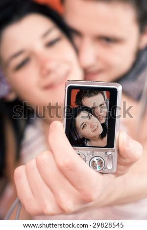 Happy couple taking their selfportraits - stock photo