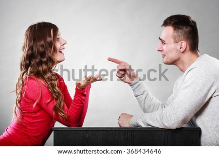 Happy couple talking and laughing on date. Smiling girl and guy having conversation. Amusing man making woman laugh. Good relationship. - stock photo
