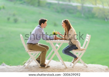happy couple talking at table - stock photo