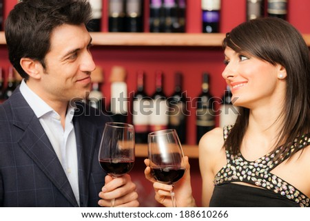 Happy couple toasting wineglasses - stock photo