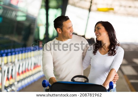 happy couple together at airport - stock photo