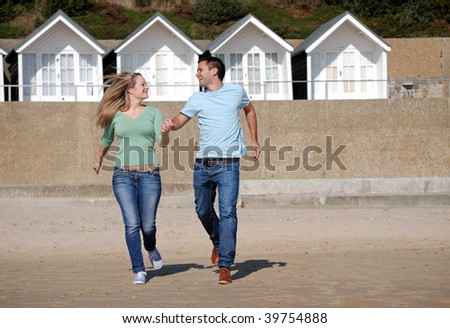 Happy couple together at the beach - stock photo