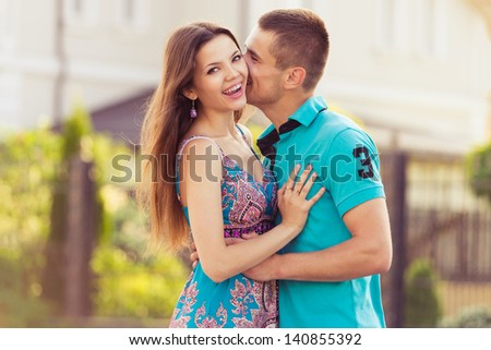 happy couple together in street. family outdoors portrait - stock photo