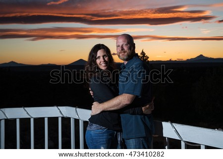 happy couple under beautiful sunset