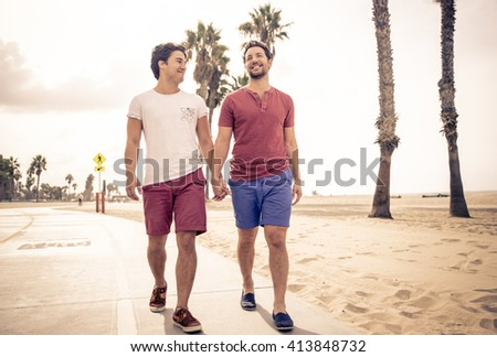 Happy couple walking in Santa monica, Los angeles - stock photo