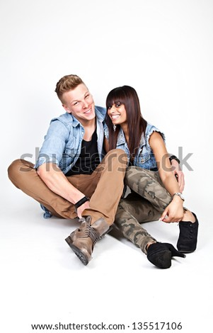 Happy couple wearing jeans