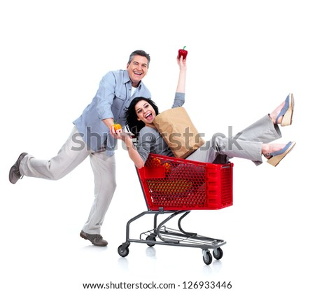 Happy couple with a grocery shopping cart. Isolated on white backgorund. - stock photo