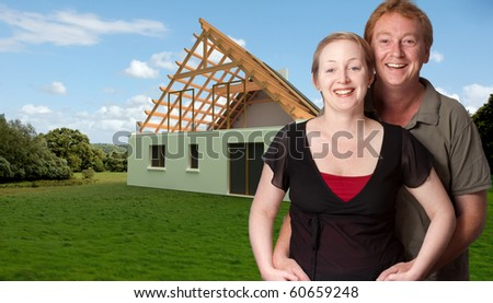 Happy couple with a house project on the background - stock photo