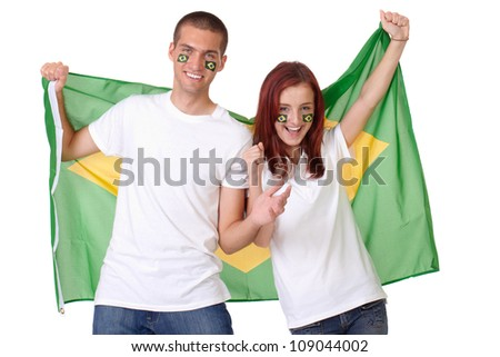 Happy couple with Brazil flags on their cheeks holds Greece flag, isolated - stock photo