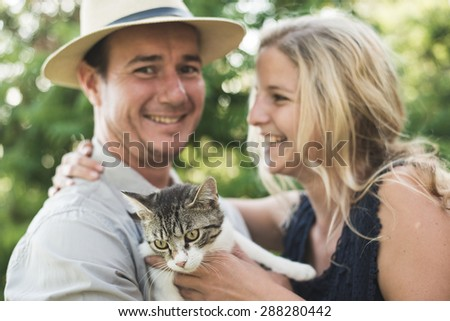 Happy couple with cute kitten - stock photo