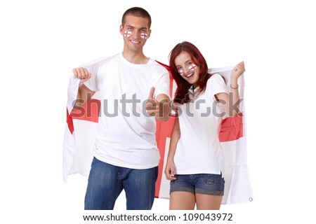 Happy couple with English flags on their cheeks holds big English flag, isolated on white