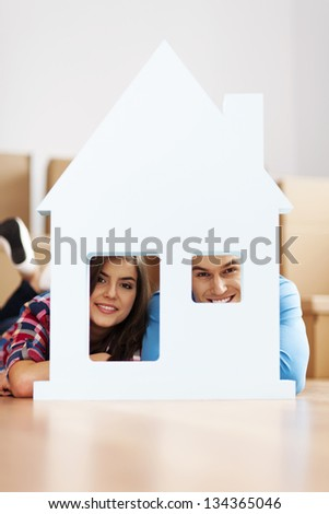Happy couple with home sign - stock photo