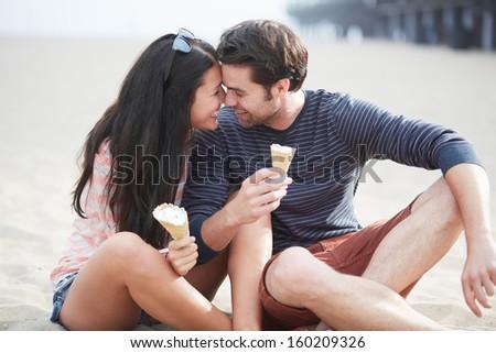 happy couple with ice cream near santa monica pier - stock photo