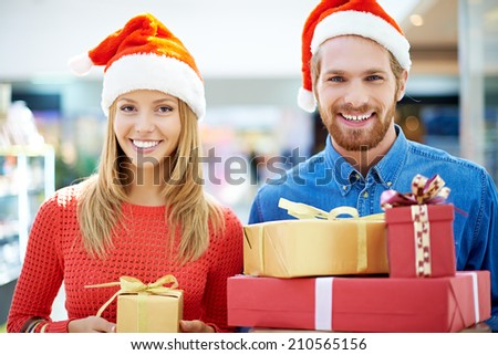 Happy couple with purchases for Christmas - stock photo
