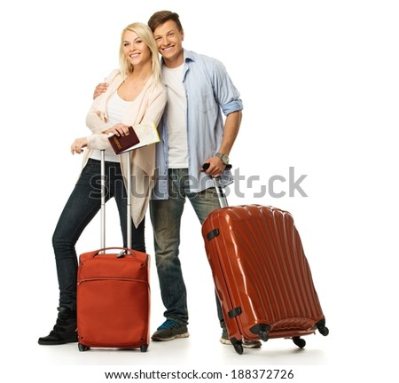 Happy couple with suitcases and map - stock photo