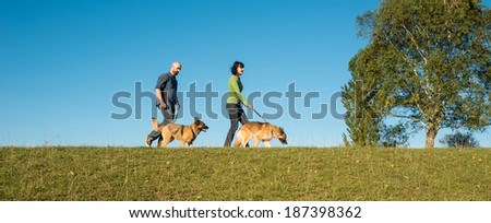 happy couple with their two dogs - stock photo