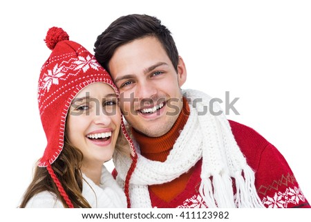 Happy couple with winter clothes embracing head to head on white background - stock photo