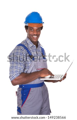 Happy Craftsman Holding Laptop Over White Background - stock photo