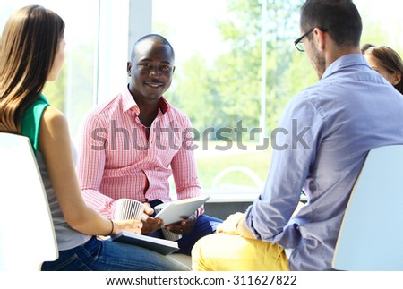 Happy creative business people in meeting - stock photo