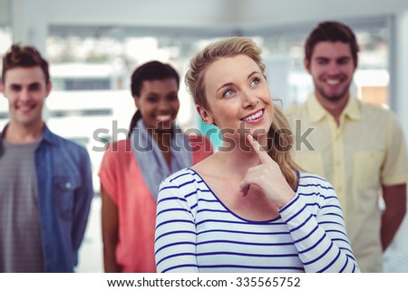 Happy creative team standing together in casual office - stock photo