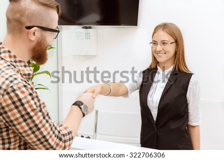 Happy customer is satisfied with the service staff - stock photo