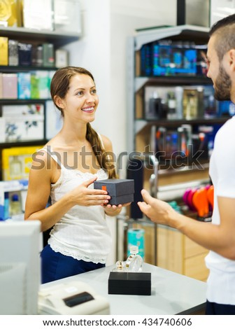 Happy customer paying for purchases in the shop - stock photo