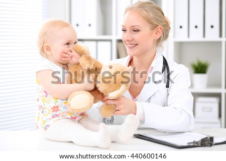 Happy cute baby  after health exam at doctor's office - stock photo