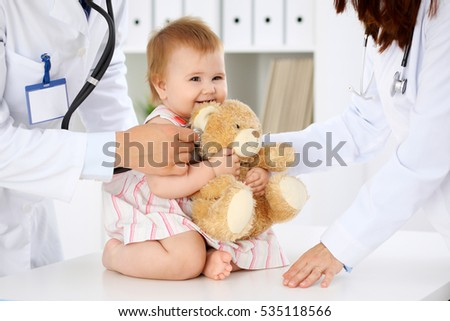 Happy cute baby  at health exam at doctor's office. Medicine and health care concept