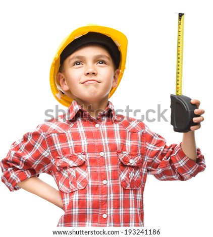 Happy cute boy as a construction worker with tape measure, isolated over white - stock photo