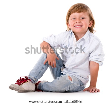 Happy cute boy sitting on the floor - isolated over white background - stock photo