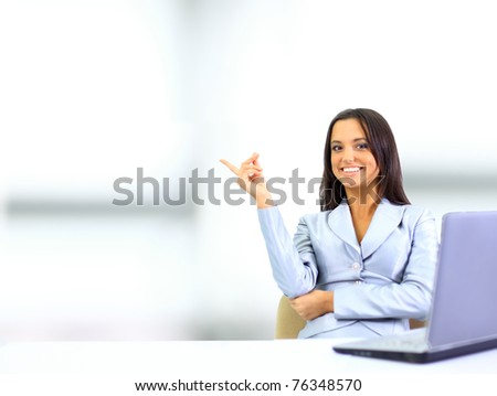 Happy cute brunette looking away with a smile - stock photo