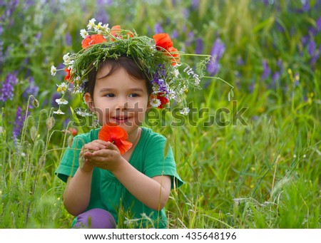 Happy cute child girl on poppies field. Happy children. Healthy lifestyle