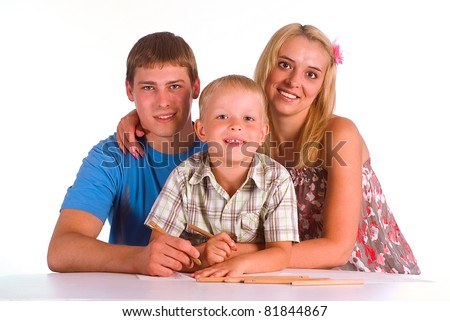 happy cute family drawing at the table